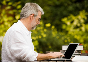 author typing an article for publication